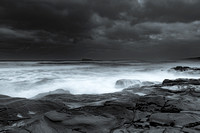 Rainy day moody seascape in monochrome