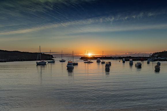 Sunrise and boats in the harbour