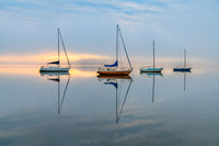 Misty Morning with Boats and Reflections on the Bay