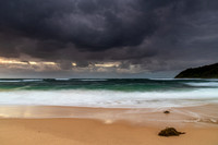 Moody morning bay seascape with rain clouds