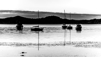 Daybreak waterscape  with boats in black and white