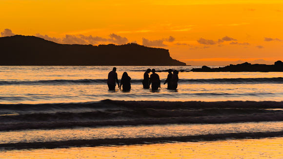 Sunrise Seascape with People Silhouettes